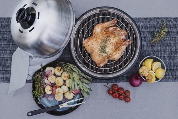 cobb premier cooker with a fully cooked meal